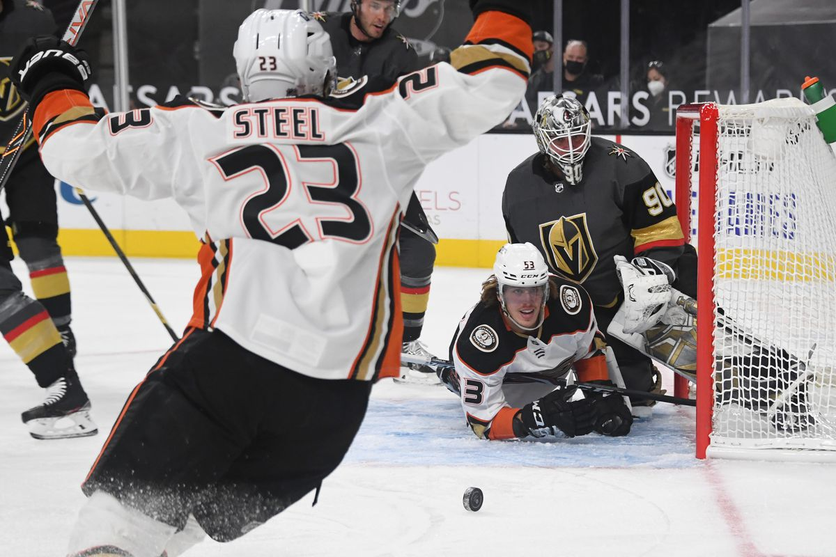 Max Comtois #53 of the Anaheim Ducks slides into Robin Lehner #90 of the Vegas Golden Knights after scoring the first of his two goals in the first period of their game at T-Mobile Arena on January 14, 2021 in Las Vegas, Nevada.