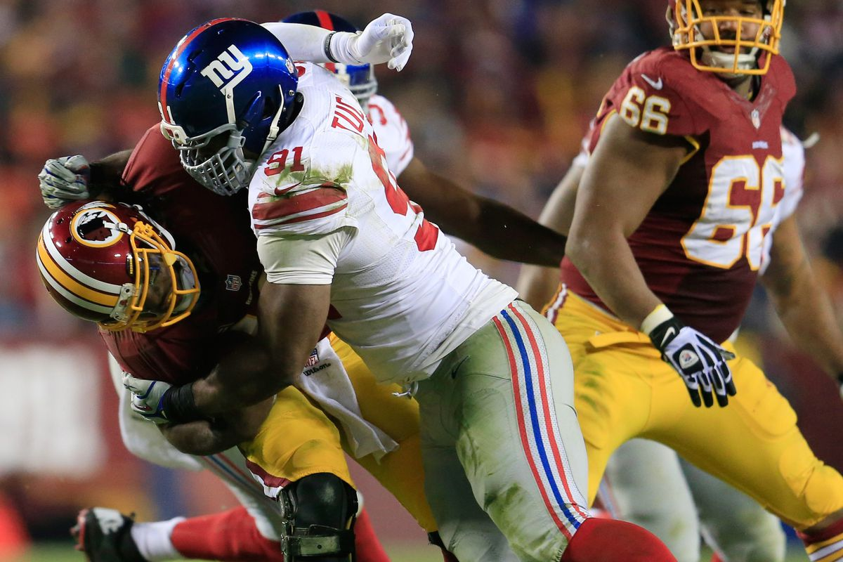 Justin Tuck gets one of his four sacks