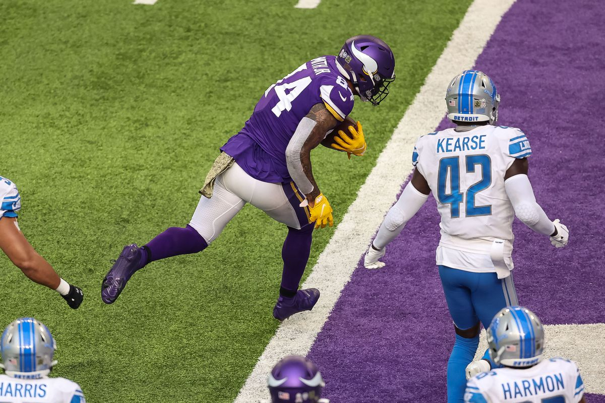 Minnesota Vikings tight end Irv Smith (84) scores a touchdown during the third quarter against the Detroit Lions at U.S. Bank Stadium.