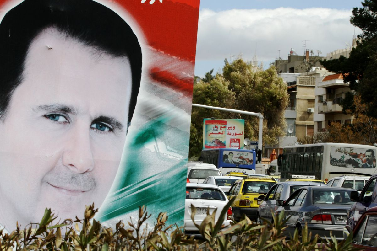 A photo taken on March 4, 2015, shows a banner bearing a portrait of Syrian President Bashar al-Assad in a street in the city of Damascus.
