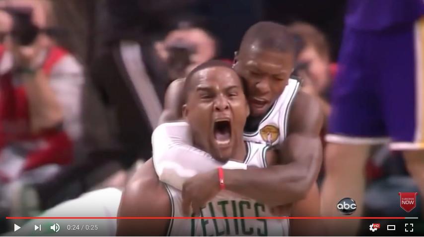 Nate Robinson celebrating with his arms around Glen Davis