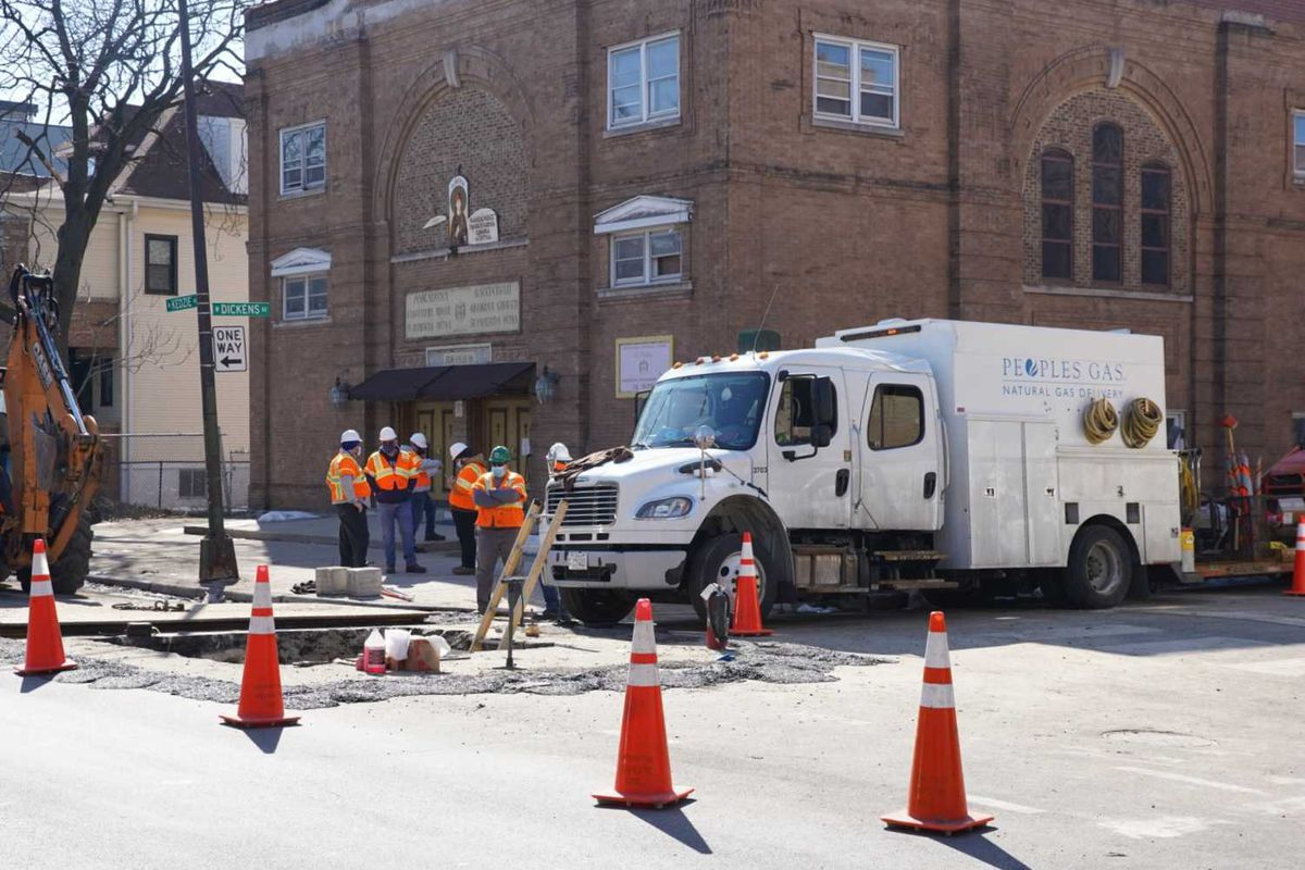 Peoples Gas crews work on a service outage March 3 on Kedzie Avenue at Dickens Avenue.