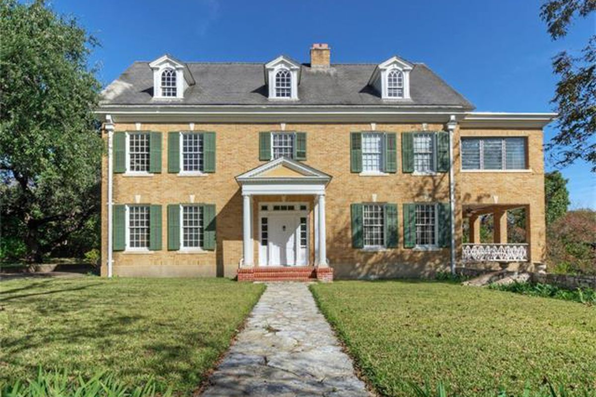 light brown/beige/yellowish brick third story Colonial revival with three dormers on top and shuttered windows