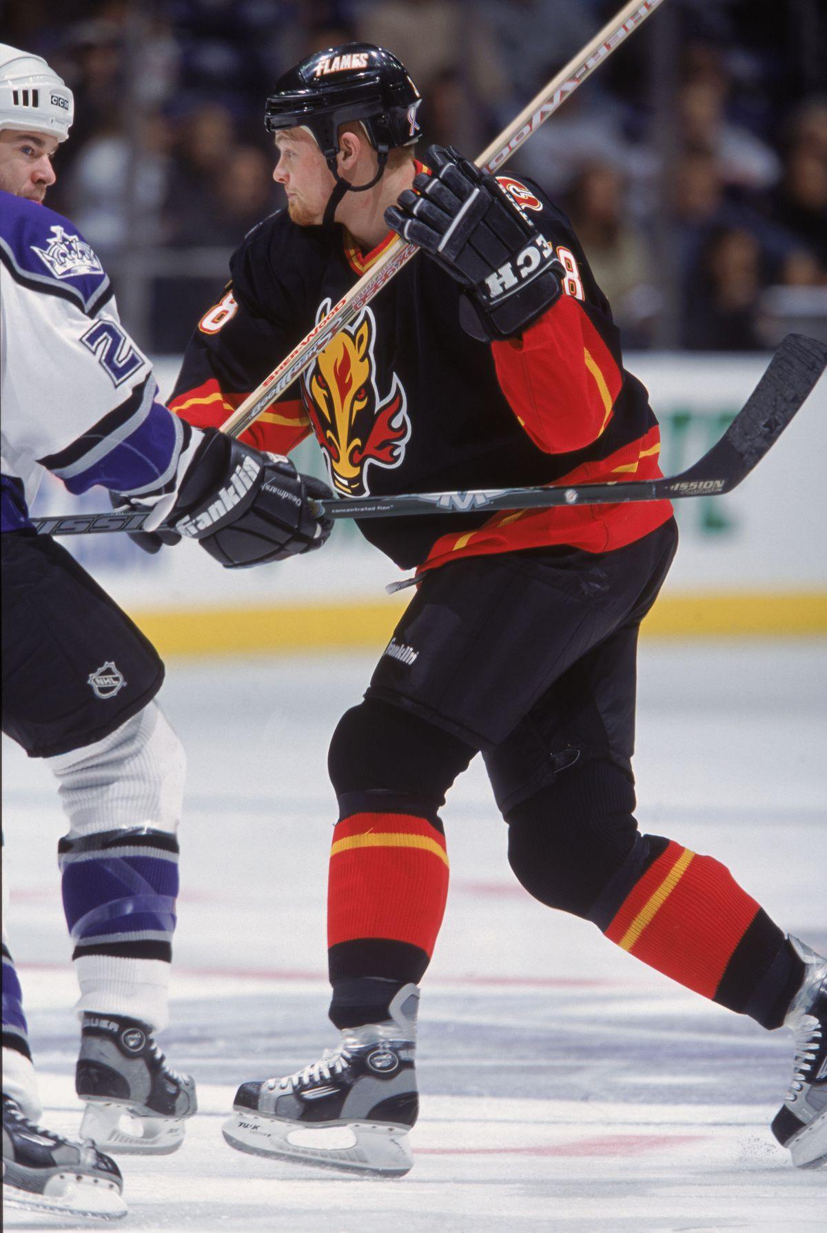 Jeff Cowan #38 skates on the ice
