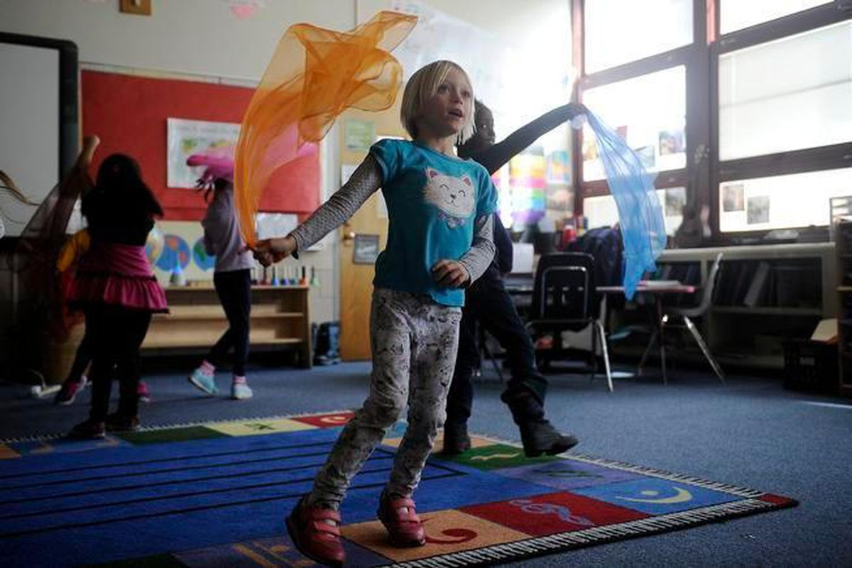 Students dance with brightly colored scarves during a music class at Gilpin Montessori (Denver Post photo).