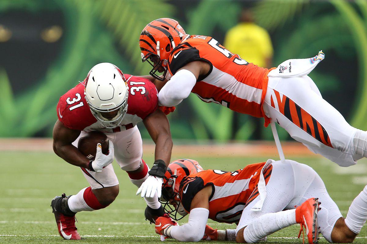 Arizona Cardinals running back David Johnson tackled by Cincinnati Bengals middle linebacker Preston Brown during the third quarter at Paul Brown Stadium.