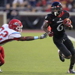 Cincinnati wide receiver Anthony McClung (6) avoids a tackle by Delaware State defensive back Cameren Judge in the first half of an NCAA college football game, Saturday, Sept. 15, 2012, in Cincinnati.