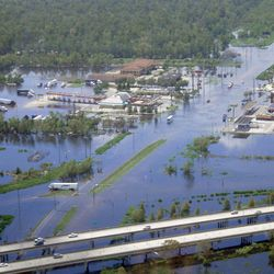 This Sept. 1, 2012 photo provided by the Louisiana Joint Information Center shows flooding in LaPlace, La. Louisiana State Police say Interstate 10, foreground, is open to traffic in both directions between New Orleans and Baton Rouge. Police spokesman Capt. Doug Cain said the highway was fully reopened just before 12 p.m. CDT Saturday. But he said police dispatchers continue to be swamped with calls about the status of the highway in the wake of Hurricane Isaac.