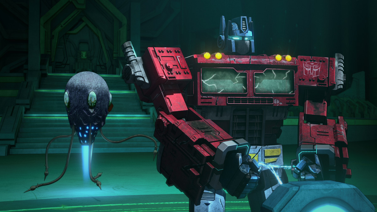 Transformers stands in front of a tentacled robot thing in War for Cybertron - Earthrise