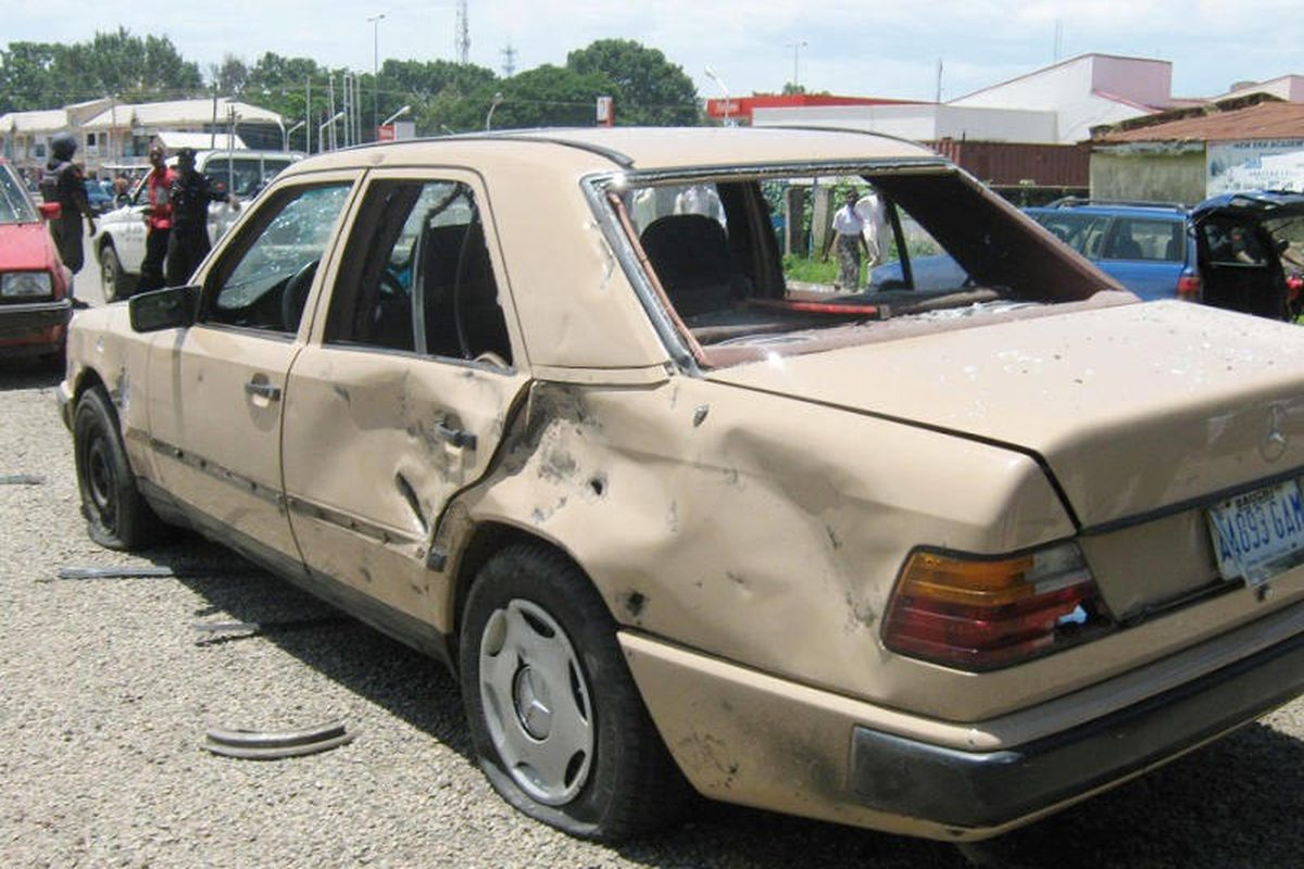 A damaged car seen after a suicide car bomb detonated at a church in Bauchi, Nigeria. Sunday, Sept. 23, 2012.  A suicide car bomber attacked a Catholic church in northern Nigeria on Sunday, killing two people and wounding another 45 in a region under assa