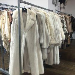 Racks on racks of fur coats