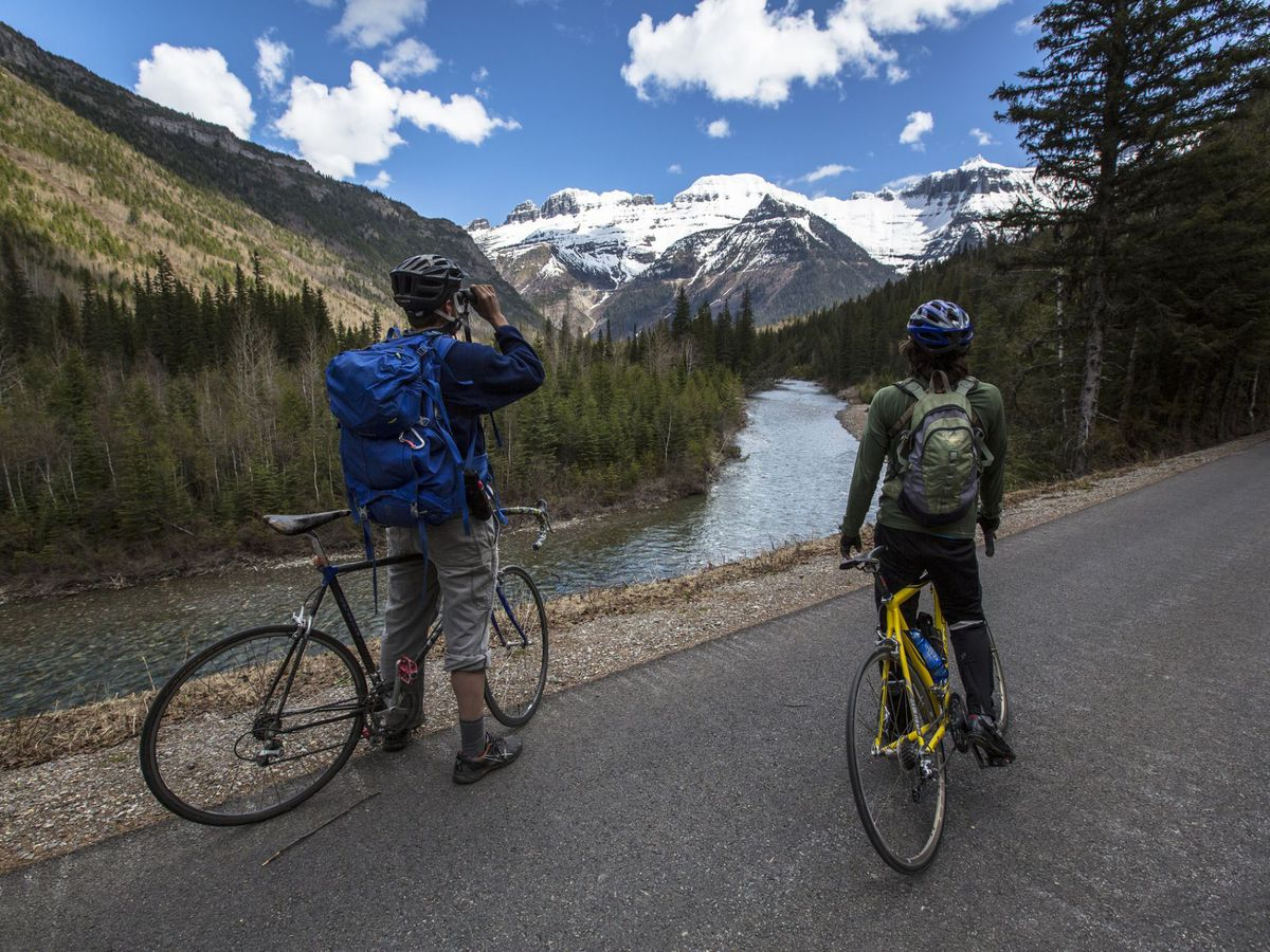Bikers enjoy the view along the nearly 50-mile-long road that runs from the Glacier Park's east and west borders. The road is mostly open to bicyclists, except for June 15 through Labor Day, when a few sections of the road are closed to bicycles between 1