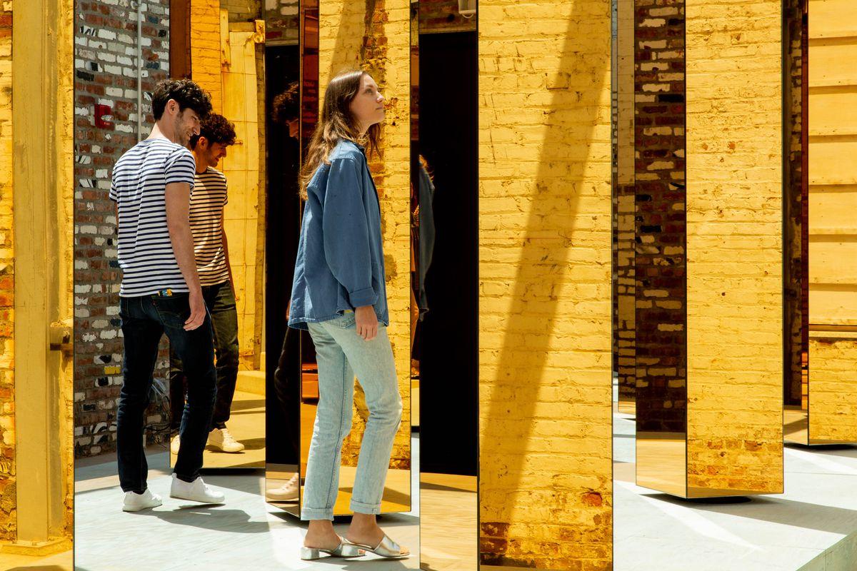 People walking around installation
