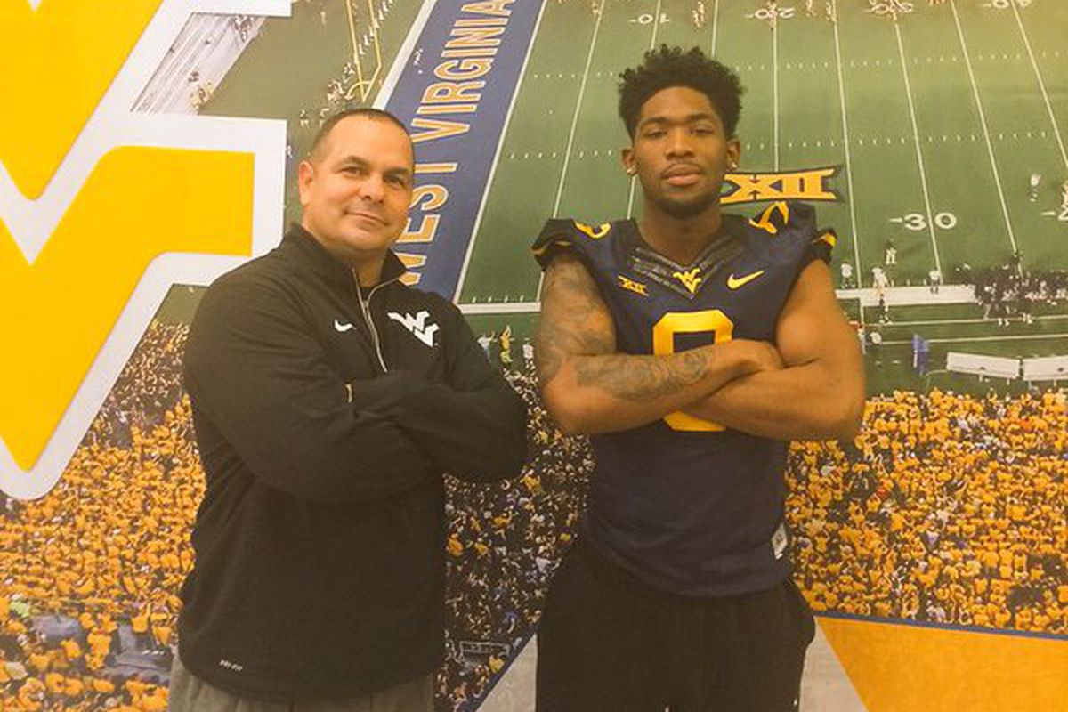 Toyous Avery and West Virginia defensive coordinator Tony Gibson