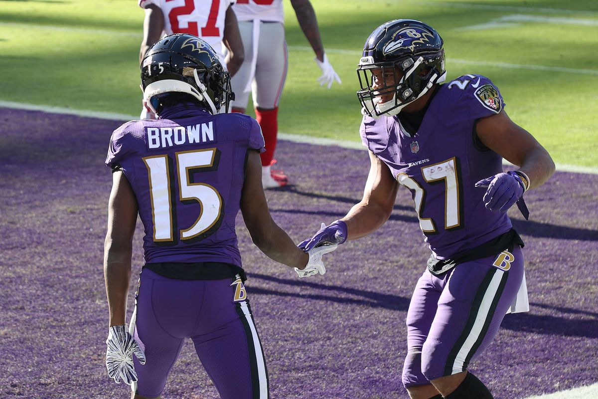 Wide receiver Marquise Brown #15 of the Baltimore Ravens celebrates a touchdown catch with teammate J.K. Dobbins #27 during the first quarter against the New York Giants at M&T Bank Stadium on December 27, 2020 in Baltimore, Maryland.