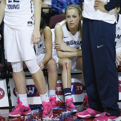 Brigham Young Cougars guard Makenzi Morrison Pulsipher (23) sits on the bench after BYU lost to the San Francisco Lady Dons during the WCC tournament championship in Las Vegas Tuesday, March 8, 2016.  San Francisco won 70-68.