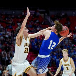 Fremont'sMitch Stratford drives to the hoop against Davis' Dylan Perrenoud in the 6A boys basketball championship game at the Huntsman Center in Salt Lake City on Saturday, Feb. 29, 2020.