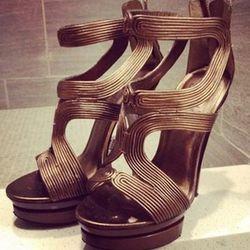 """<a href=""""http://www.threadflip.com/items/5279""""> Pelle dark brown wrap around platform heels, $35.00</a>"""