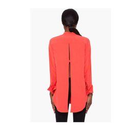 "<a href=""http://www.ssense.com/women/product/carven/coral_open_back_blouse/50136""> Carven open back blouse</a>, $258 ssense.com"