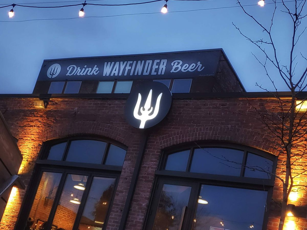 Outside entrance and deck of Wayfinder Brewery