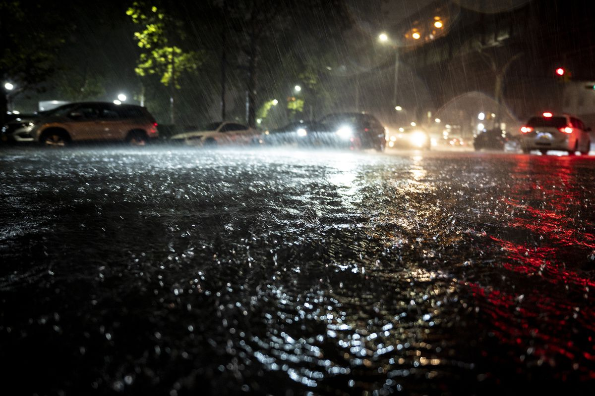 Cars try to drive through rising flood water down Leonard St in Brooklyn, Sept. 1, 2021.