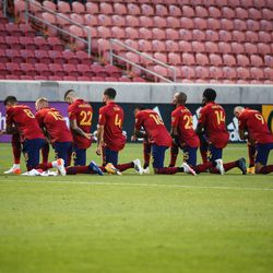 Real Salt Lake players take a knee during the national anthem before an MLS soccer game against Colorado Rapids at Rio Tinto Stadium in Sandy on Saturday, Sept. 12, 2020.
