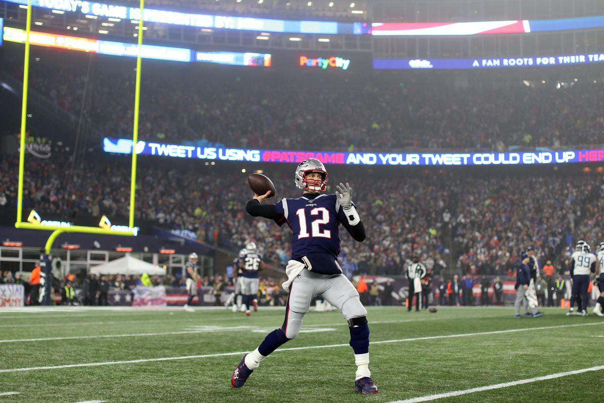 Tom Brady of the New England Patriots warms up during the AFC Wild Card Playoff game against the Tennessee Titans at Gillette Stadium on January 04, 2020 in Foxborough, Massachusetts.
