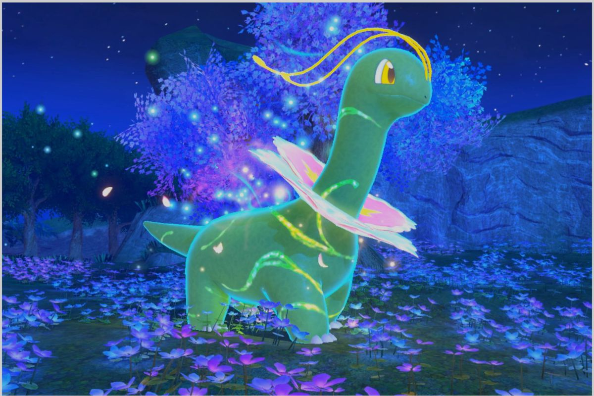 A glowing Meganium with swirls on its body stands in a flowery field