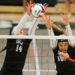 Timpview players makes a dual-block in a UHSAA 5A volleyball state championship game at Hillcrest High School in Midvale on Saturday, Nov. 7, 2020.