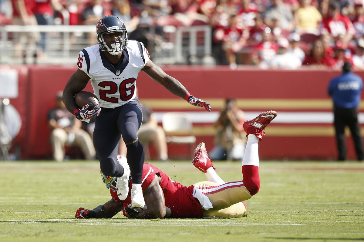 Lamar Miller breaks a tackle against the 49ers during the first preseason game