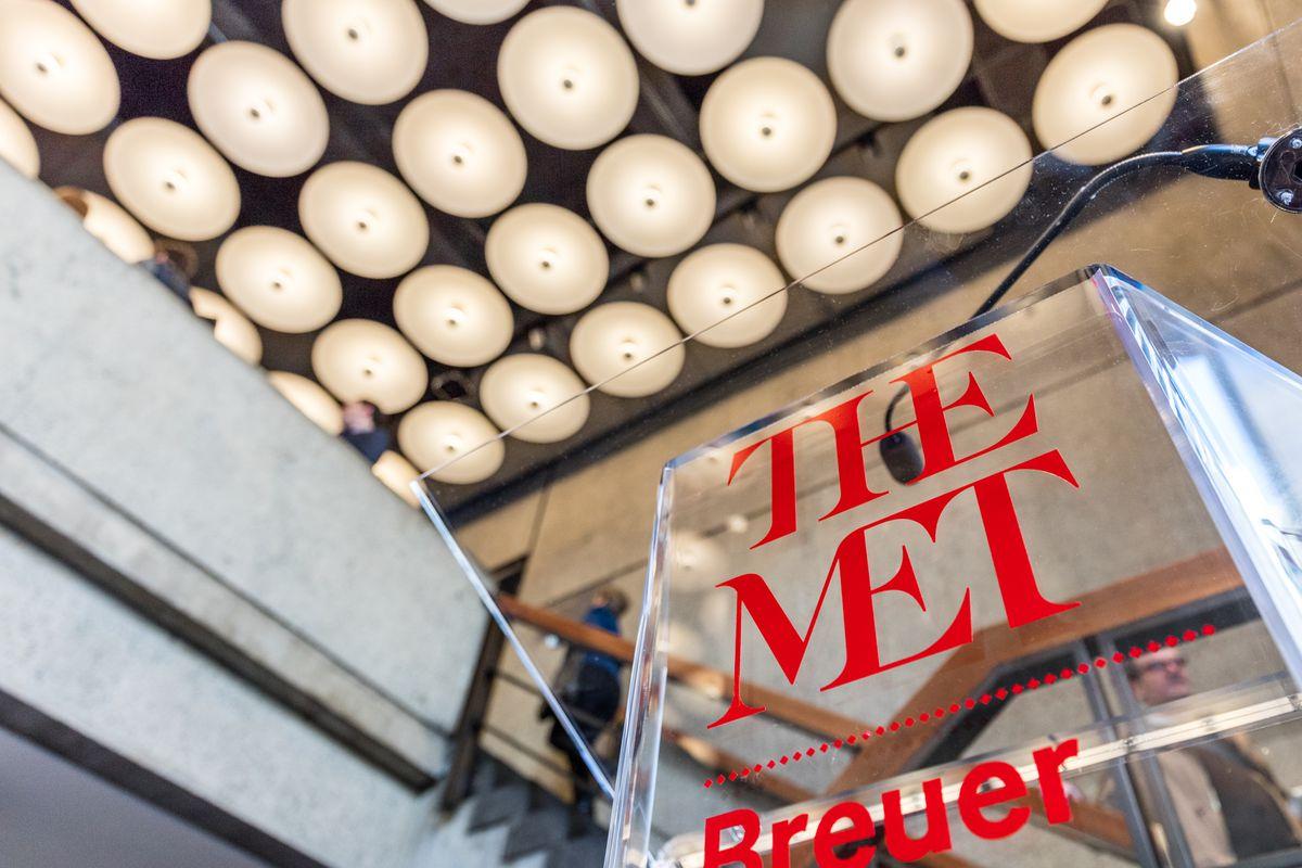 The Met Breuer's new branding, set off against the restored Marcel Breuer lights in the lobby of the former Whitney Museum.