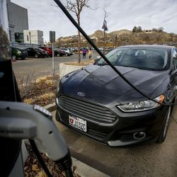 A Ford Fusion charges outside the Capitol in Salt Lake City on Wednesday, Feb. 8, 2017. HB29, a legislative proposal to keep electric vehicle tax credits alive but phase them out entirely six years from now remains a work in progress, with negotiations continuing between its sponsor and other lawmakers.