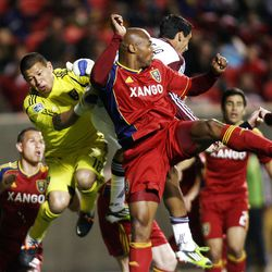 Goalkeeper Nick Rimando and Jamison Olave of Real Salt Lake battles to clear the ball on a corner kick against Martin Rivero of the Colorado Rapids during their MLS match up at Rio Tinto Stadium in Sandy Saturday, April 7, 2012.