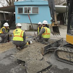 Dominion Energy crews work on a line rupture at a trailer park in Magna on Wednesday, March 18, 2020, following a 5.7 magnitude earthquake struck the area.