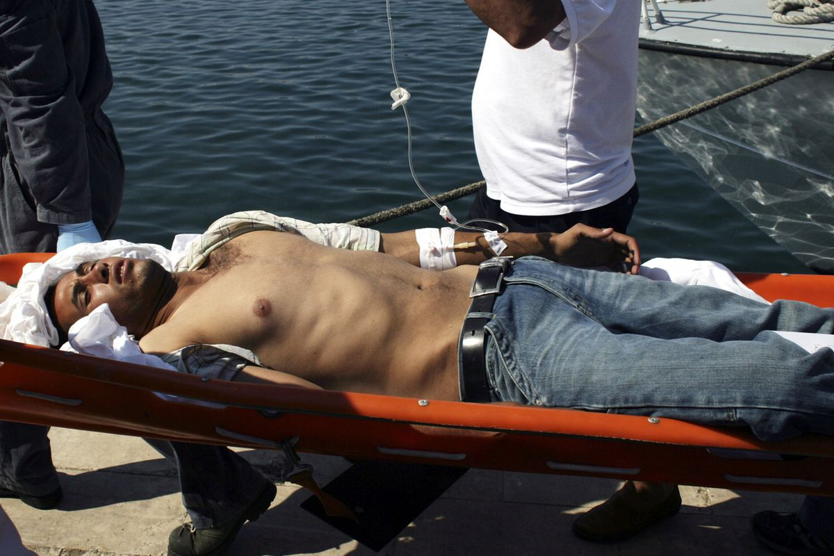 A migrant is carried on a stretcher on Lampedusa, an Italian island that's a frequent destination for migrants.