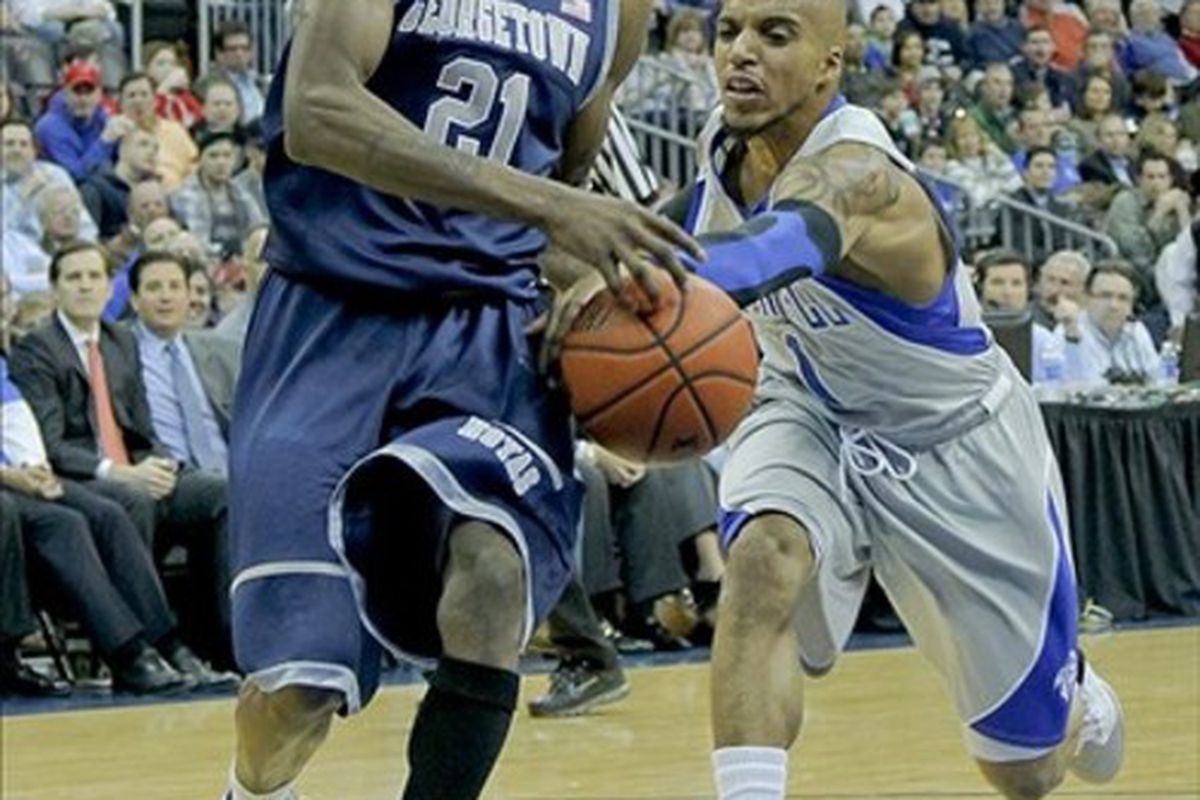 Feb 21, 2012; Newark, NJ, USA;  Seton Hall Pirates guard Jordan Theodore (1) reaches in and stripes ball from Georgetown Hoyas guard Jason Clark (21) as he drives to the basket at the Prudential Center. Mandatory Credit: Jim O'Connor-US PRESSWIRE