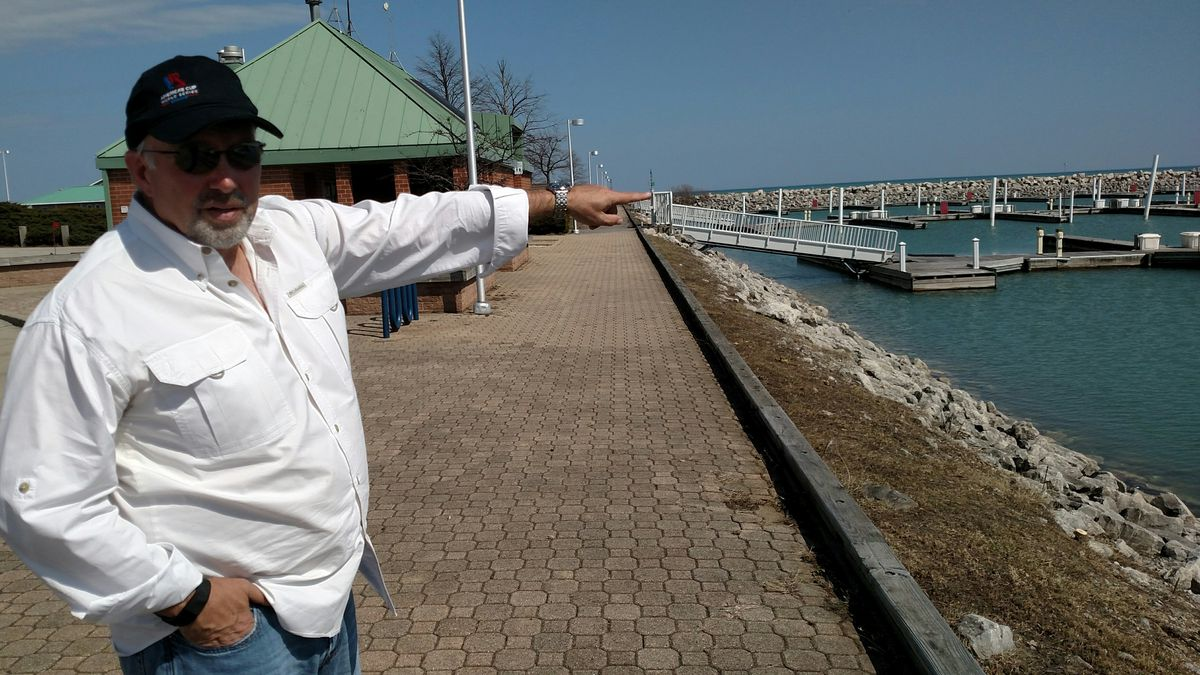 Scott Stevenson explains some of the work being done at North Point Marina.<br>Credit: Dale Bowman
