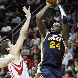 Utah Jazz's Paul Millsap (24) shoots over Houston Rockets' Chandler Parsons on Wednesday night.