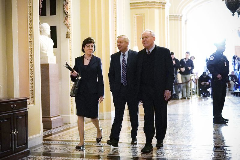 Sen. Susan Collins (R-ME), Sen. Lindsey Graham (R-SC) and Sen. Lamar Alexander (R-TN) arrive for a Senate Republican policy luncheon just after the House had passed the tax overhaul bill and before the Senate was expected to vote, on December 19, 2017.