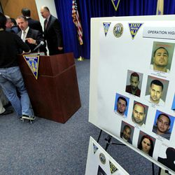 Mug shots of an alleged luxury car theft ring are on display at the end of a news conference, Tuesday, April 17, 2012, in Newark, N.J. Prosecutors say the Newark-based thieves traveled to affluent communities from Bergen to Ocean counties in search of luxury vehicles. They would usually strike during the early morning and most often would grab cars that still had their keys inside. Eleven people have been arrested, most of them from Newark. Among the vehicles recovered were a Porsche, a Ferrari, a Mercedes and two BMWs.