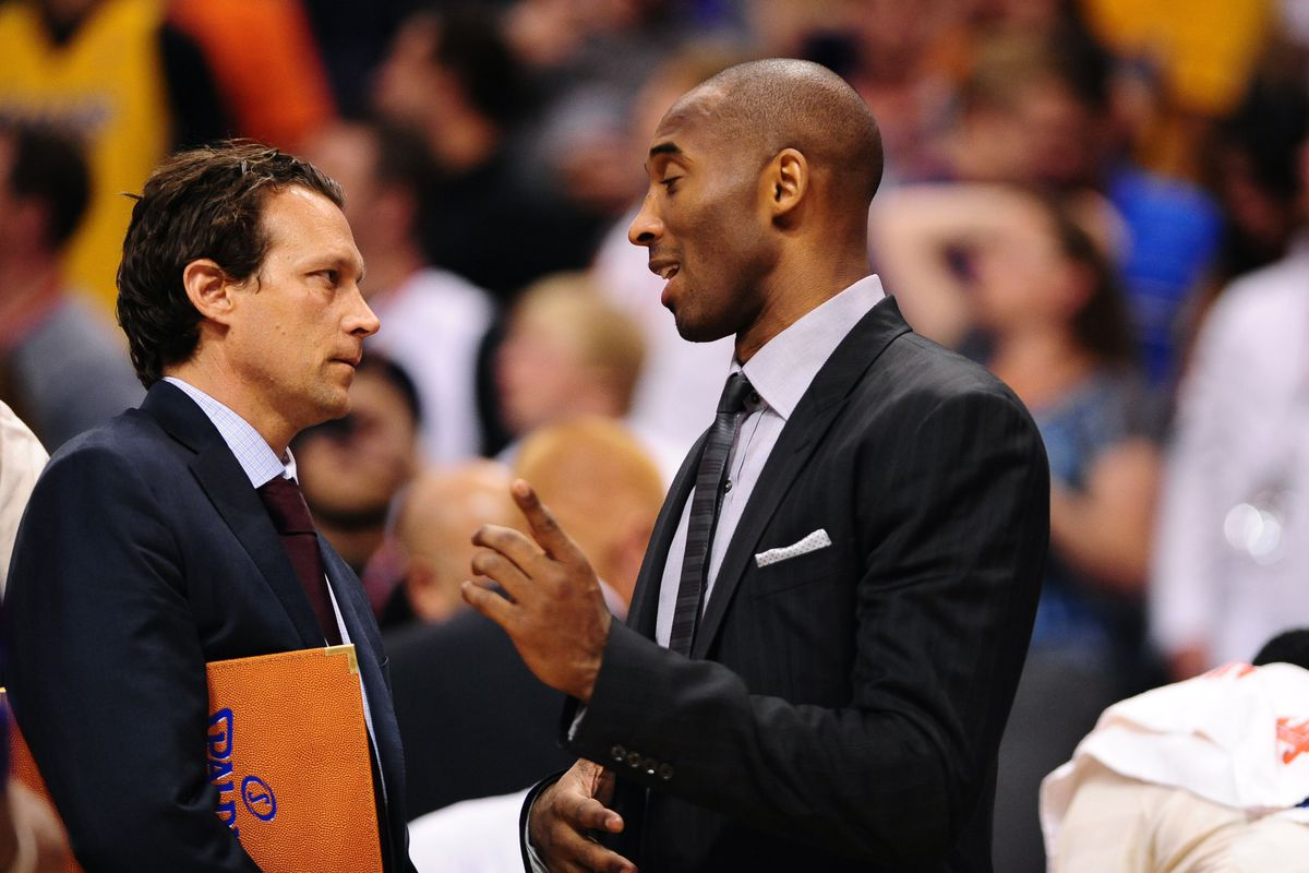 New Utah Jazz Head Coach Quin Snyder being instructed by Kobe Bryant