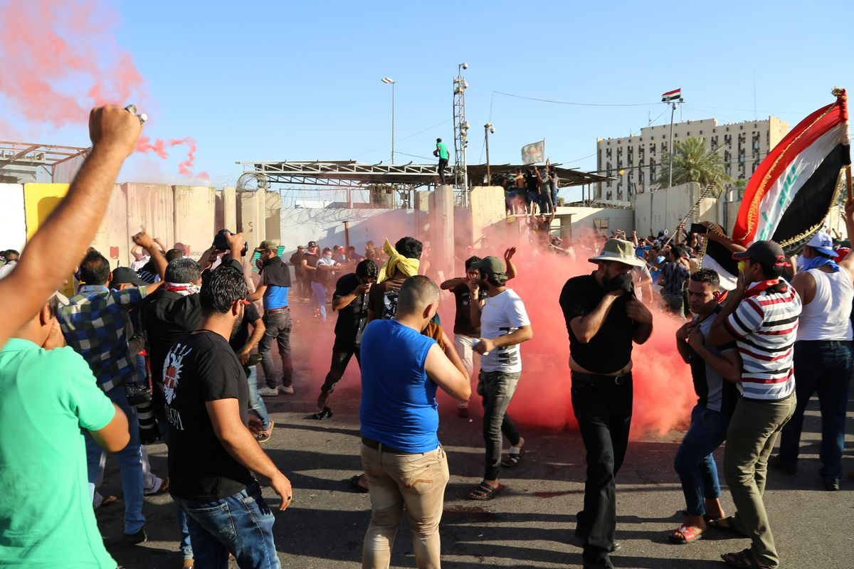 Security forces use tear gas as the supporters of Shia cleric Muqtada al-Sadr try to enter the Green Zone in Baghdad, Iraq, on May 20, 2016.