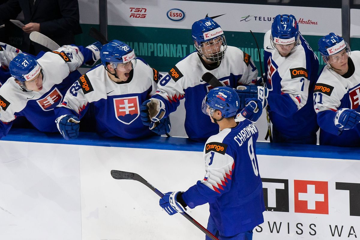 Martin Chromiak #8 of Slovakia celebrates with his teammates after scoring a goal against Canada during the 2021 IIHF World Junior Championship at Rogers Place on December 27, 2020 in Edmonton, Canada.