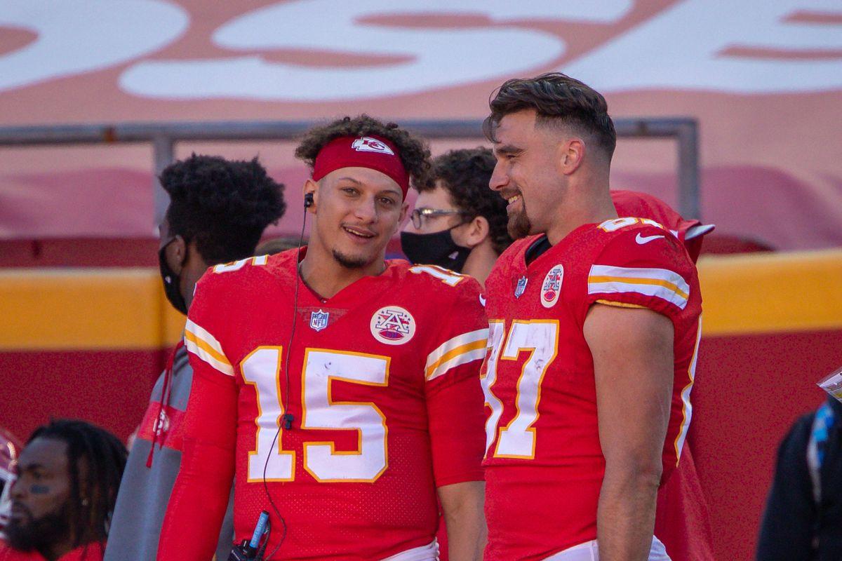 Kansas City Chiefs quarterback Patrick Mahomes and Kansas City Chiefs tight end Travis Kelce talk on the sidelines during the second half against the New York Jets on November 1, 2020 at Arrowhead Stadium in Kansas City, Missouri.