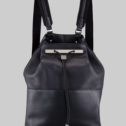 """Like Logan Square, backpacks are making a comeback in the quirkiest, kitschiest way possible. Subtle silver details make <a href=""""http://www.therow.com/collection_spring2013_accessories#10"""">The Row's </a> take on the trend truly special."""