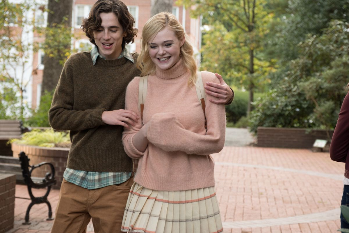 Timothée Chalamet and Elle Fanning playing college students and embracing.