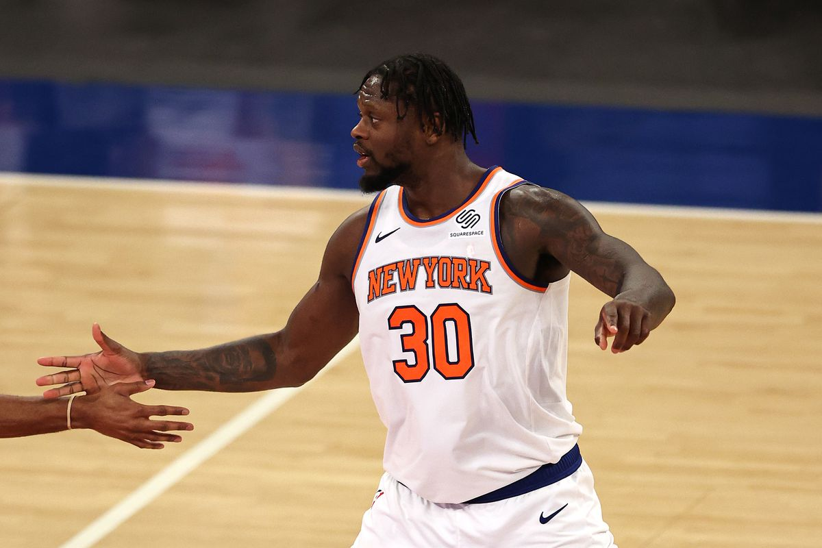 Julius Randle of the New York Knicks celebrates late in overtime after he fed the ball to Alec Burks and he shot a three pointer against the Charlotte Hornets at Madison Square Garden on May 15, 2021 in New York City.The New York Knicks defeated the Charlotte Hornets 118-109.