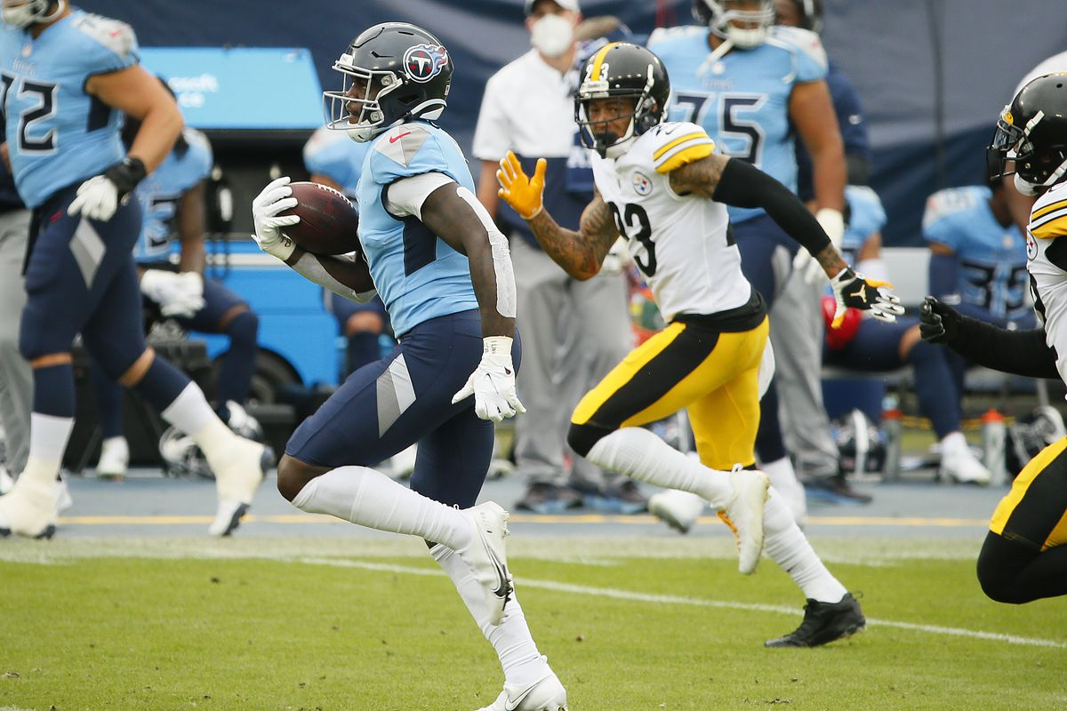 A.J. Brown #11 of the Tennessee Titans runs for a touchdown reception against the Pittsburgh Steelers during the second half at Nissan Stadium on October 25, 2020 in Nashville, Tennessee.