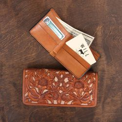 Billfold wallet, $195. Available in black, brown, tan.