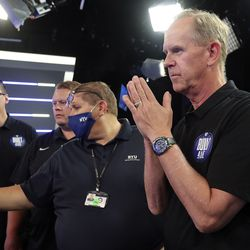 BYU athletic director Tom Holmoe watches an interview wrap-up during BYU football media day at the BYU Broadcasting Building in Provo on Thursday, June 17, 2021.